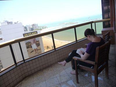 Reading-on-balcony